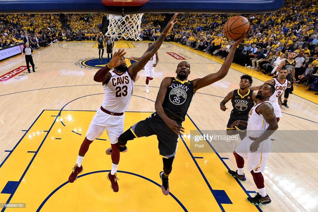 Kevin Durant #35 of the Golden State Warriors attempts a layup over LeBron James #23 of the Cleveland Cavaliers during the second quarter in Game 2 of the 2018 NBA Finals at ORACLE Arena on June 3, 2018 in Oakland, California.