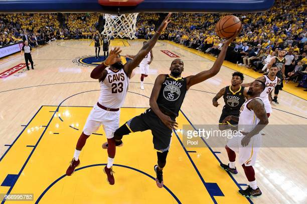 Kevin Durant of the Golden State Warriors attempts a layup over LeBron James of the Cleveland Cavaliers during the second quarter in Game 2 of the...