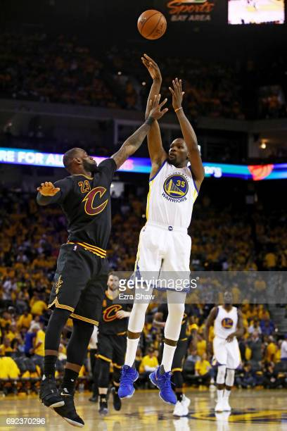 Kevin Durant of the Golden State Warriors attempts a shot defended by LeBron James of the Cleveland Cavaliers during the second half of Game 2 of the...