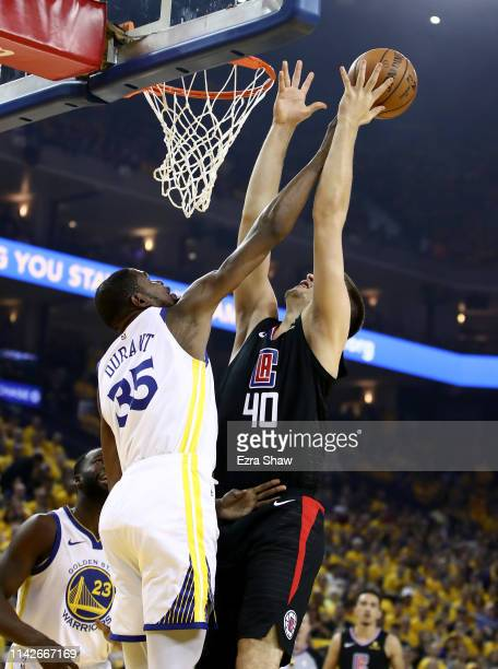 Kevin Durant of the Golden State Warriors blocks a shot by Ivica Zubac of the LA Clippers during Game One of the first round of the 2019 NBA Western...