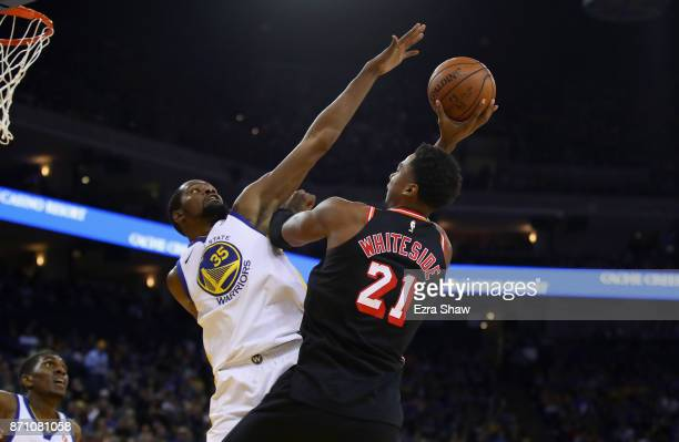 Kevin Durant of the Golden State Warriors blocks a shot taken by Hassan Whiteside of the Miami Heat at ORACLE Arena on November 6 2017 in Oakland...