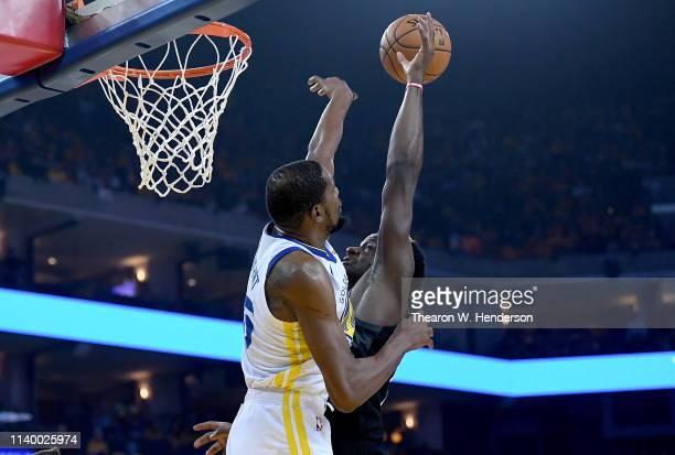 Kevin Durant of the Golden State Warriors blocks the attempted dunk of Clint Capela of the Houston Rockets during Game One of the Second Round of the...