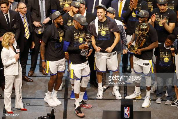 Kevin Durant of the Golden State Warriors celebrate on stage with the Bill Russell Finals MVP Trophy after winning Game Four of the 2018 NBA Finals...