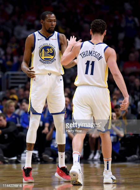 Kevin Durant of the Golden State Warriors celebrates a basket with Klay Thompson during a 113105 win over the LA Clippers in Game Four of Round One...