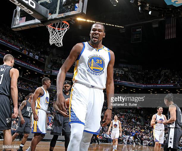Kevin Durant of the Golden State Warriors celebrates a dunk during the game against the Brooklyn Nets on December 22 2016 at Barclays Center in...