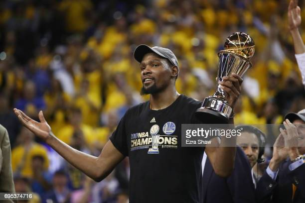 Kevin Durant of the Golden State Warriors celebrates after being named Bill Russell NBA Finals Most Valuable Player after defeating the Cleveland...