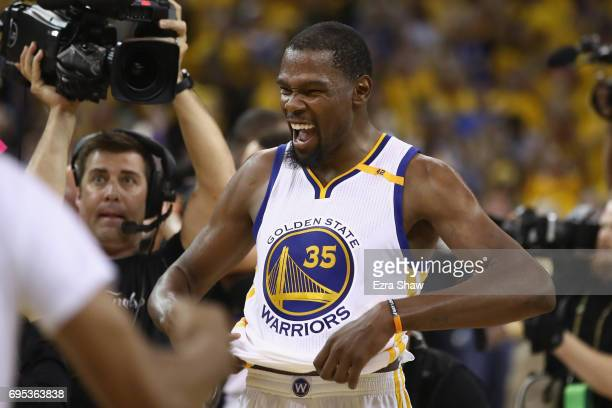 Kevin Durant of the Golden State Warriors celebrates after defeating the Cleveland Cavaliers 129120 in Game 5 to win the 2017 NBA Finals at ORACLE...