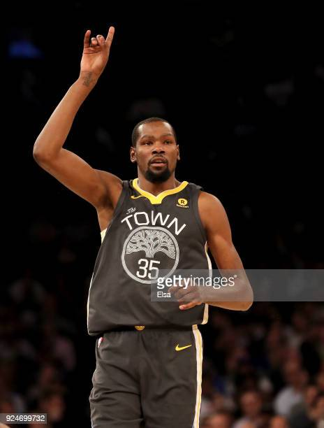 Kevin Durant of the Golden State Warriors celebrates his three point shot in the first half against the New York Knicks at Madison Square Garden on...