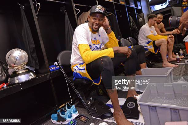 Kevin Durant of the Golden State Warriors celebrates in the locker room after winning Game Four of the Western Conference Finals against the San...
