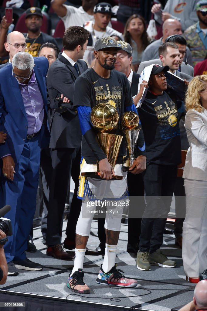 OH - Kevin Durant #35 of the Golden State Warriors celebrates while holding the Bill Russell NBA Finals Most Valuable Player Trophy and the Larry O'Brien NBA Championship Trophy after Game Four of the 2018 NBA Finals on June 8, 2018 at Quicken Loans Arena in Cleveland, Ohio.