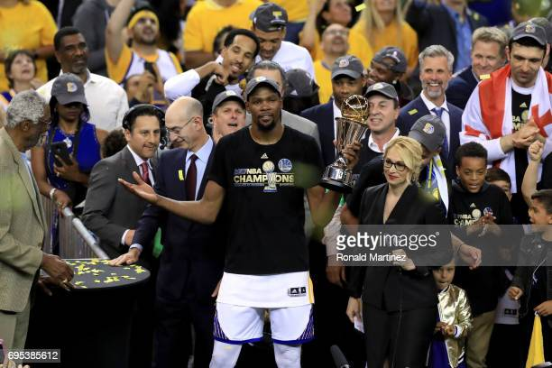Kevin Durant of the Golden State Warriors celebrates with the Bill Russell NBA Finals Most Valuable Player Award after defeating the Cleveland...