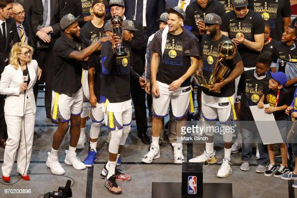 Kevin Durant of the Golden State Warriors celebrates with the Bill Russell Finals MVP Trophy after winning Game Four of the 2018 NBA Finals against...