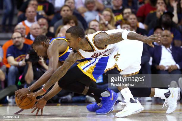 Kevin Durant of the Golden State Warriors competes for the ball with JR Smith of the Cleveland Cavaliers in the first half in Game 3 of the 2017 NBA...