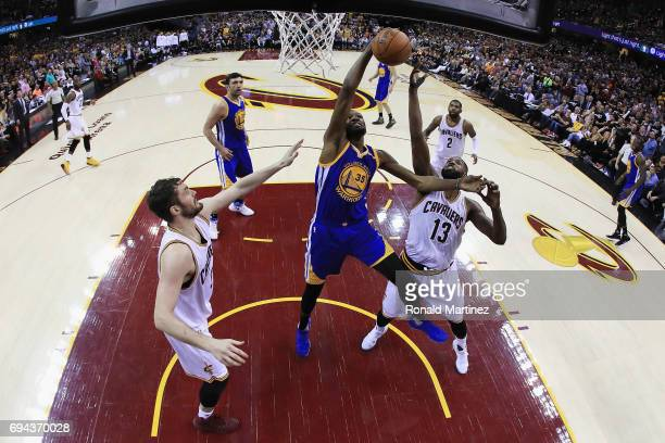 Kevin Durant of the Golden State Warriors competes for the ball with Tristan Thompson of the Cleveland Cavaliers in the second half in Game 4 of the...