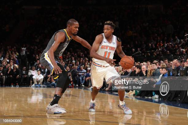 Kevin Durant of the Golden State Warriors defends against Frank Ntilikina of the New York Knicks during the game on October 26 2018 at Madison Square...