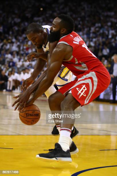 Kevin Durant of the Golden State Warriors defends against James Harden of the Houston Rockets during their NBA game at ORACLE Arena on October 17...