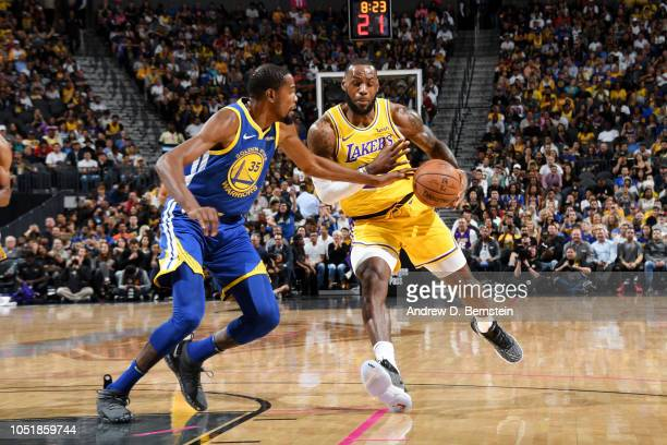 Kevin Durant of the Golden State Warriors defends against LeBron James of the Los Angeles Lakers during a preseason game on October 10 2018 at...