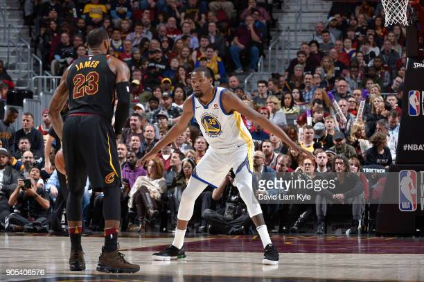 Kevin Durant of the Golden State Warriors defends against LeBron James of the Cleveland Cavaliers on January 15 2018 at Quicken Loans Arena in...