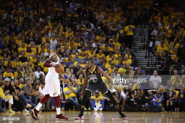 Kevin Durant of the Golden State Warriors defends against LeBron James of the Cleveland Cavaliers in Game 2 of the 2018 NBA Finals at ORACLE Arena on...