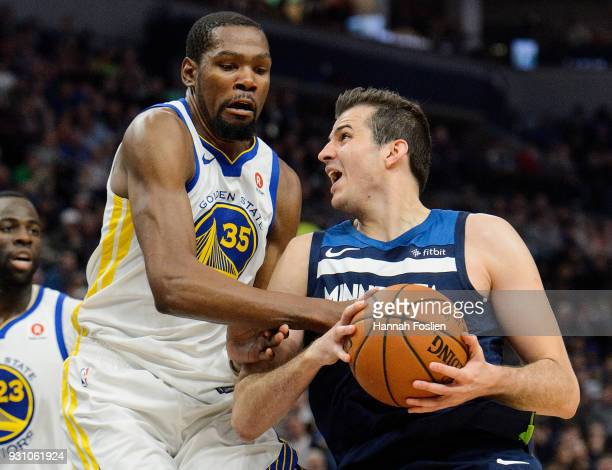 Kevin Durant of the Golden State Warriors defends against Nemanja Bjelica of the Minnesota Timberwolves during the game on March 11 2018 at the...