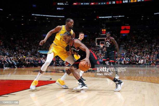Kevin Durant of the Golden State Warriors defends Kawhi Leonard of the Toronto Raptors on November 29 2018 at Scotiabank Arena in Toronto Ontario...