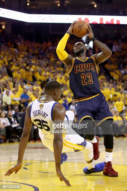 Kevin Durant of the Golden State Warriors draws a foul by LeBron James of the Cleveland Cavaliers in Game 1 of the 2017 NBA Finals at ORACLE Arena on...