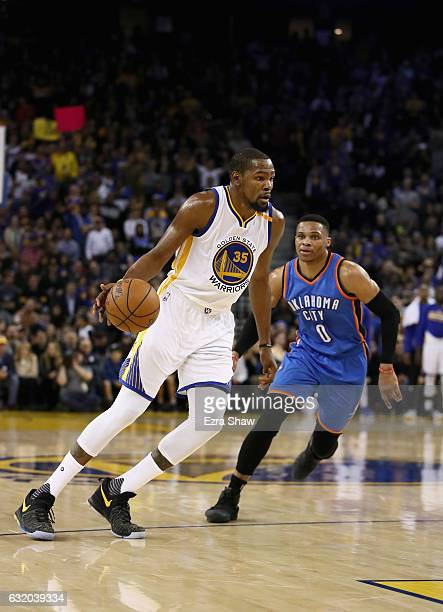 Kevin Durant of the Golden State Warriors dribbles past Russell Westbrook of the Oklahoma City Thunder at ORACLE Arena on January 18 2017 in Oakland...