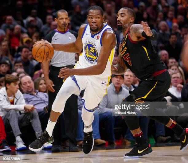 Kevin Durant of the Golden State Warriors dribbles the ball against JR Smith of the Cleveland Cavaliers at Quicken Loans Arena on January 15 2018 in...