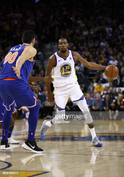 Kevin Durant of the Golden State Warriors dribbles up court against the New York Knicks at ORACLE Arena on January 23 2018 in Oakland California NOTE...
