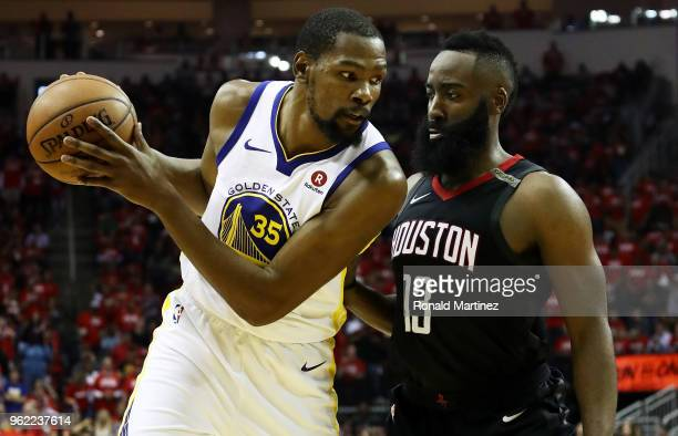 24e08c59d57 Kevin Durant of the Golden State Warriors drives against James Harden of  the Houston Rockets in