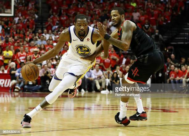 Kevin Durant of the Golden State Warriors drives against Trevor Ariza of the Houston Rockets in the third quarter of Game Seven of the Western...