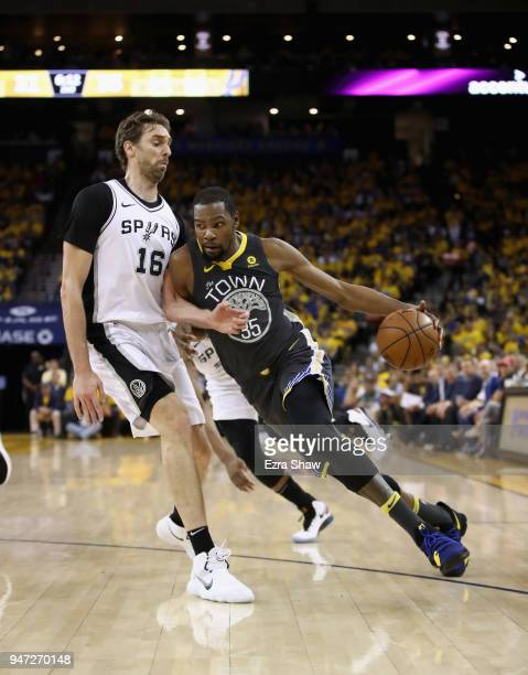 Kevin Durant of the Golden State Warriors drives on Pau Gasol of the San Antonio Spurs during Game 2 of Round 1 of the 2018 NBA Playoffs at ORACLE...