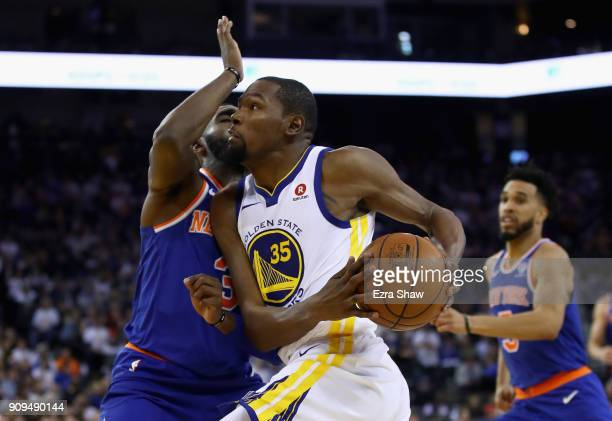 Kevin Durant of the Golden State Warriors drives on Tim Hardaway Jr #3 of the New York Knicks at ORACLE Arena on January 23 2018 in Oakland...