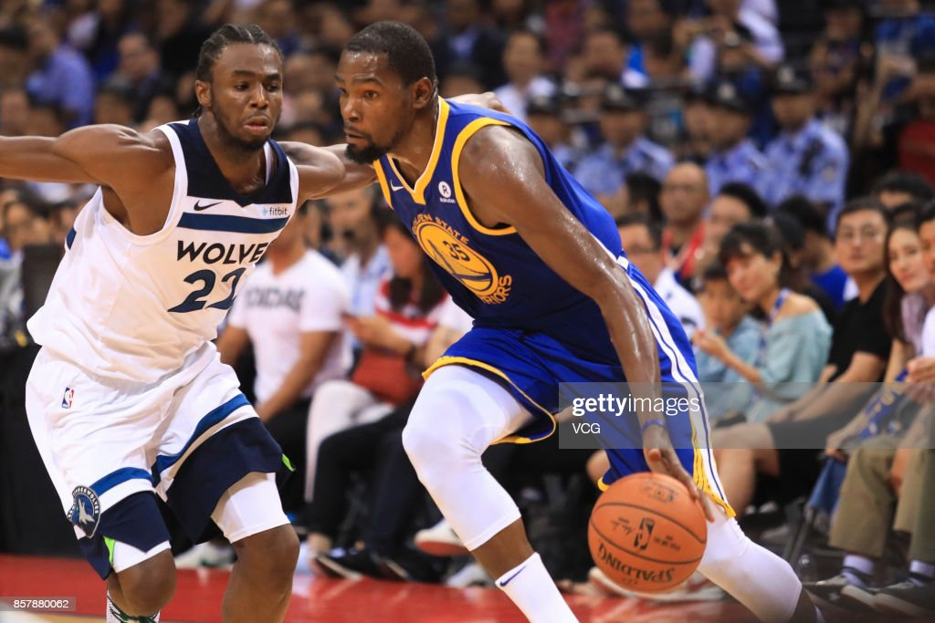Kevin Durant #35 of the Golden State Warriors drives the ball against Andrew Wiggins #22 of the Minnesota Timberwolves during the game between the Minnesota Timberwolves and the Golden State Warriors as part of 2017 NBA Global Games China at Shenzhen Universidade on October 5, 2017 in Shenzhen, China.