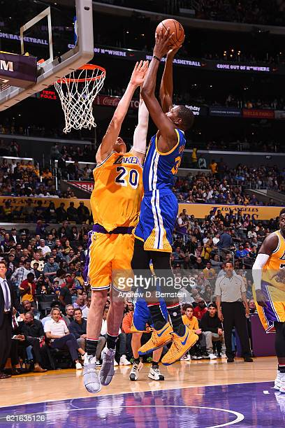 Kevin Durant of the Golden State Warriors drives to the basket and dunks the ball over Timofey Mozgov of the Los Angeles Lakers on November 4 2016 at...