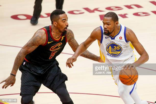 Kevin Durant of the Golden State Warriors drives to the basket defended by JR Smith of the Cleveland Cavaliers during Game Four of the 2018 NBA...