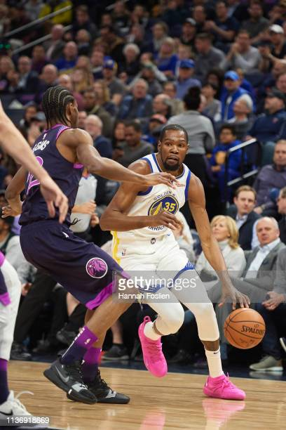 Kevin Durant of the Golden State Warriors drives to the basket against Andrew Wiggins of the Minnesota Timberwolves during the first quarter of the...