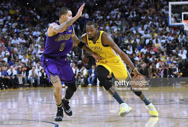 Kevin Durant of the Golden State Warriors drives to the basket on Kyle Kuzma of the Los Angeles Lakers during the second half of their NBA Basketball...