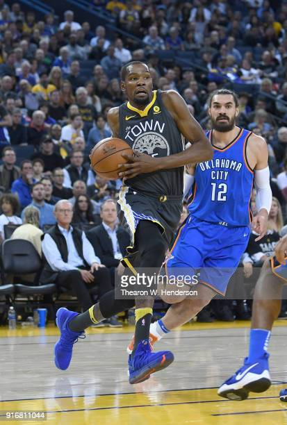 Kevin Durant of the Golden State Warriors drives to the basket on Steven Adams of the Oklahoma City Thunder during the second half of their NBA...