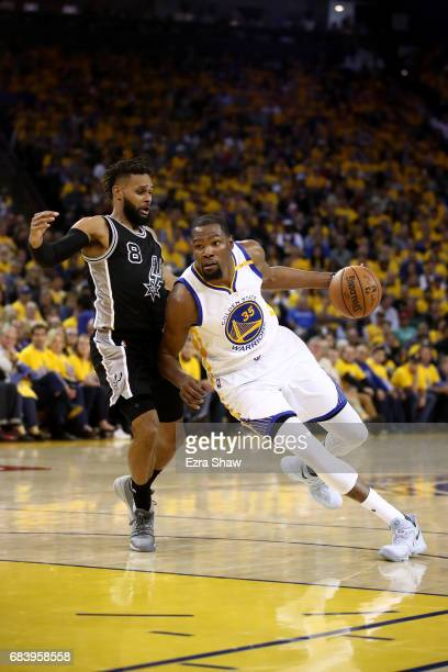 Kevin Durant of the Golden State Warriors drives with the ball against Patty Mills of the San Antonio Spurs during Game Two of the NBA Western...