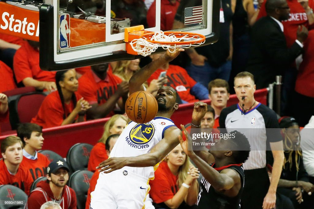 Kevin Durant #35 of the Golden State Warriors dunks against Clint Capela #15 of the Houston Rockets in the second half of Game Two of the Western Conference Finals of the 2018 NBA Playoffs at Toyota Center on May 16, 2018 in Houston, Texas.