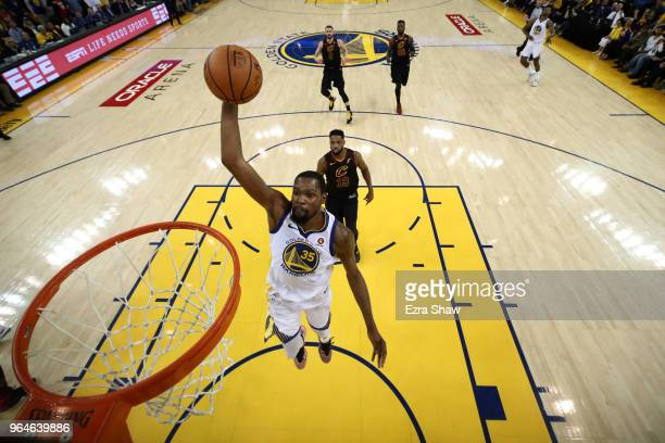 Kevin Durant of the Golden State Warriors dunks against the Cleveland Cavaliers during the first half in Game 1 of the 2018 NBA Finals at ORACLE...