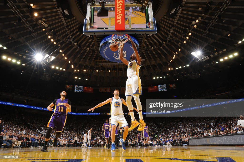Kevin Durant #35 of the Golden State Warriors dunks against the Los Angeles Lakers on April 12, 2017 at ORACLE Arena in Oakland, California.