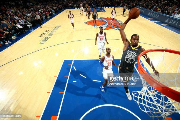 Kevin Durant of the Golden State Warriors dunks the ball against the New York Knicks on October 26 2018 at Madison Square Garden in New York City New...