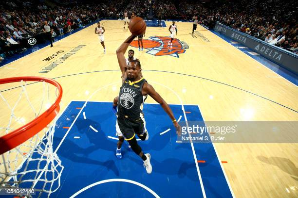 e4ed8845274 Kevin Durant of the Golden State Warriors dunks the ball against the New  York Knicks on