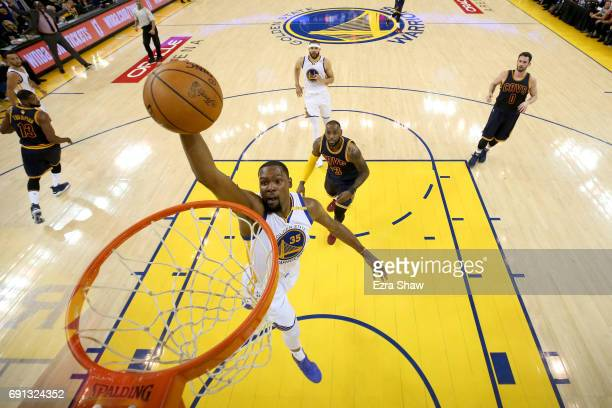 Kevin Durant of the Golden State Warriors dunks the ball against the Cleveland Cavaliers in Game 1 of the 2017 NBA Finals at ORACLE Arena on June 1,...