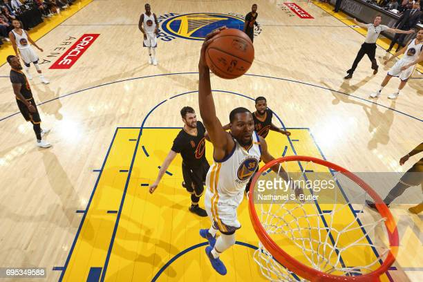 Kevin Durant of the Golden State Warriors dunks the ball against the Cleveland Cavaliers in Game Five of the 2017 NBA Finals on June 12 2017 at...