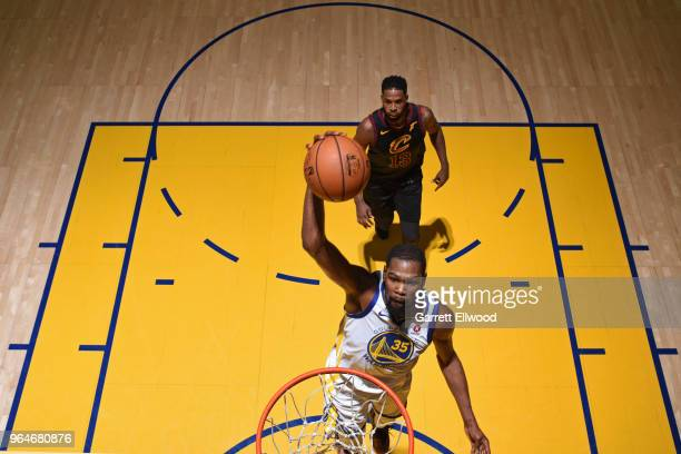 Kevin Durant of the Golden State Warriors dunks the ball against the Cleveland Cavaliers during Game One of the 2018 NBA Finals on May 31 2018 at...