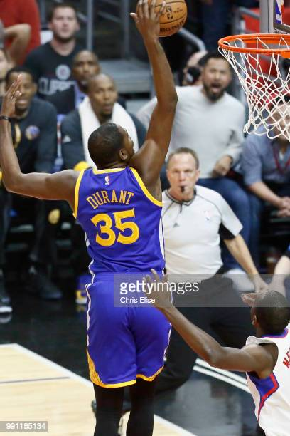Kevin Durant of the Golden State Warriors dunks the ball against the LA Clippers on December 7 2016 at the STAPLES Center in Los Angeles California...