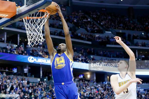 Kevin Durant of the Golden State Warriors dunks the ball against the Denver Nuggets on February 13 2017 at the Pepsi Center in Denver Colorado NOTE...